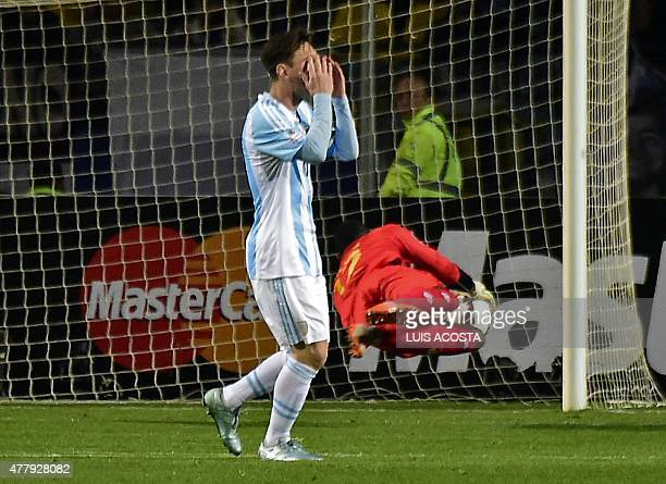 Argentina's forward Lionel Messi reacts to Jamaica's goalkeeper Dwayne Miller save during their 2015 Copa America football championship match in Vina...