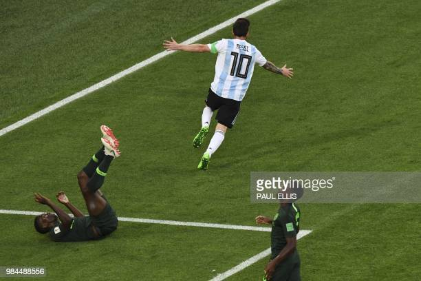 TOPSHOT Argentina's forward Lionel Messi runs in celebration after opening the scoring during the Russia 2018 World Cup Group D football match...