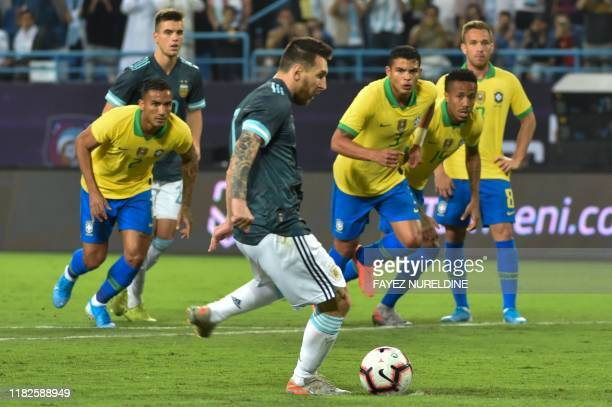 Argentina's forward Lionel Messi runs up to take a penalty during the friendly football match between Brazil and Argentina at the King Saud...