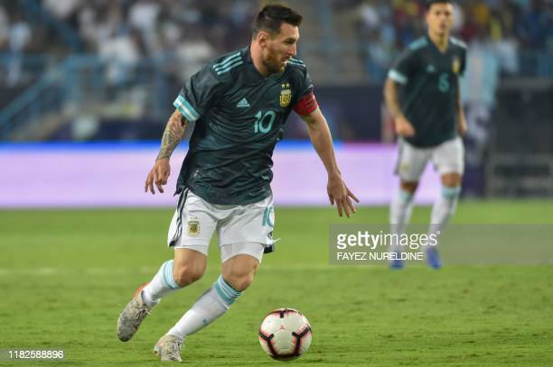 Argentina's forward Lionel Messi runs with the ball during the friendly football match between Brazil and Argentina at the King Saud University...