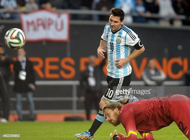 Argentina's forward Lionel Messi scores during a friendly football match against Slovenia in preparation for the Brazil 2014 FIFA World Cup at La...