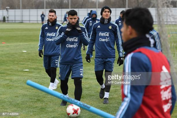 Argentina's forward Lionel Messi Sergio Aguero and teammates take part in a training session in Moscow on November 7 2017 The team will face Russia...