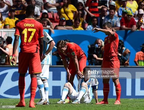 Argentina's forward Lionel Messi sits next to Belgium's forward Divock Origi Belgium's defender Jan Vertonghen and Belgium's midfielder Eden Hazard...