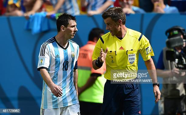 Argentina's forward Lionel Messi speaks with Italian referee Nicola Rizzoli during a quarterfinal football match between Argentina and Belgium at the...
