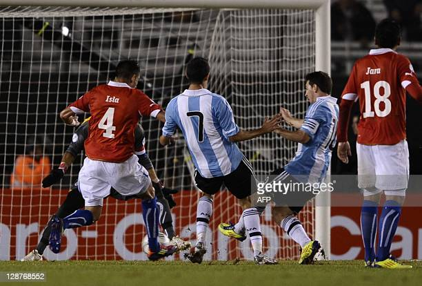 Argentina's forward Lionel Messi strikes at the goal to score the team's second goal against Chile during the Brazil 2014 World Cup South American...