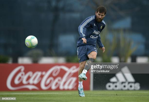 Argentina's forward Lionel Messi strikes the ball during a training session in Ezeiza Buenos Aires on August 29 2017 ahead of their FIFA World Cup...