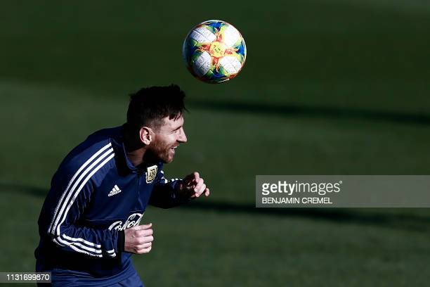 Argentina's forward Lionel Messi takes part in a training session at Real Madrid's training facilities of Valdebebas in Madrid on March 20 ahead of...