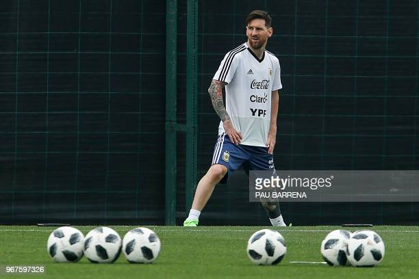 Argentina's forward Lionel Messi takes part in a training session at the FC Barcelona 'Joan Gamper' sports centre in Sant Joan Despi near Barcelona...