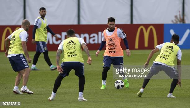 Argentina's forward Lionel Messi takes part in a training session at the team's base camp in Bronnitsy near Moscow Russia on June 11 ahead of the...