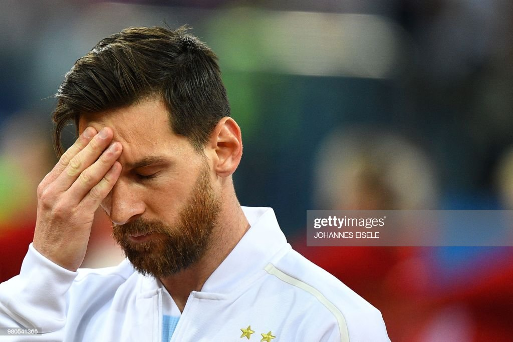 Argentina's forward Lionel Messi touches his forehead before the Russia 2018 World Cup Group D football match between Argentina and Croatia at the Nizhny Novgorod Stadium in Nizhny Novgorod on June 21, 2018. (Photo by Johannes EISELE / AFP) / RESTRICTED