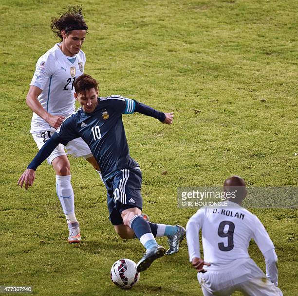 Argentina's forward Lionel Messi Uruguay's forward Edinson Cavani and Uruguay's forward Diego Rolan vie for the ball during their 2015 Copa America...