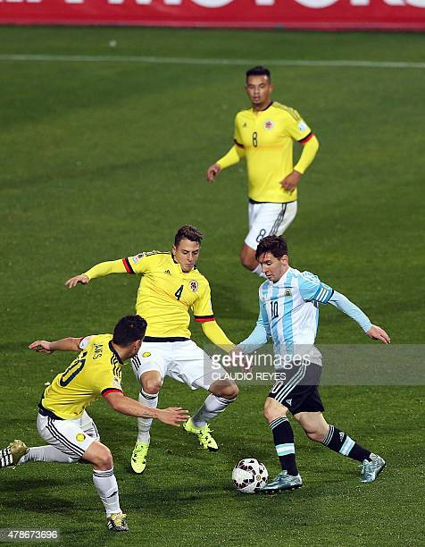 Argentina's forward Lionel Messi vies for the ball with Colombia's defender Santiago Arias and midfielder James Rodriguez during the 2015 Copa...