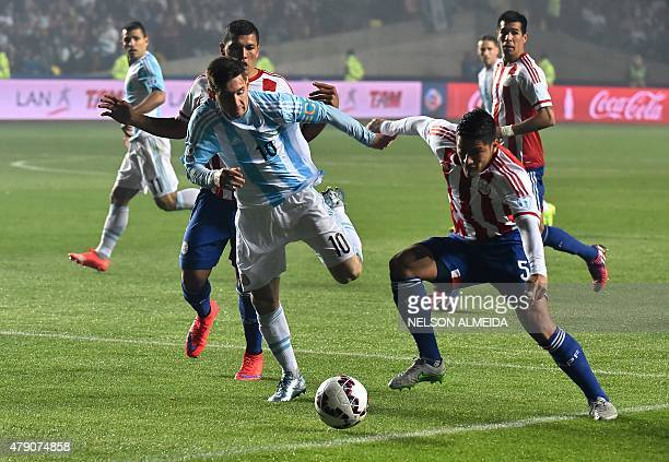 Argentina's forward Lionel Messi vies for the ball with Paraguay's defender Bruno Valdez during their Copa America semifinal football match in...