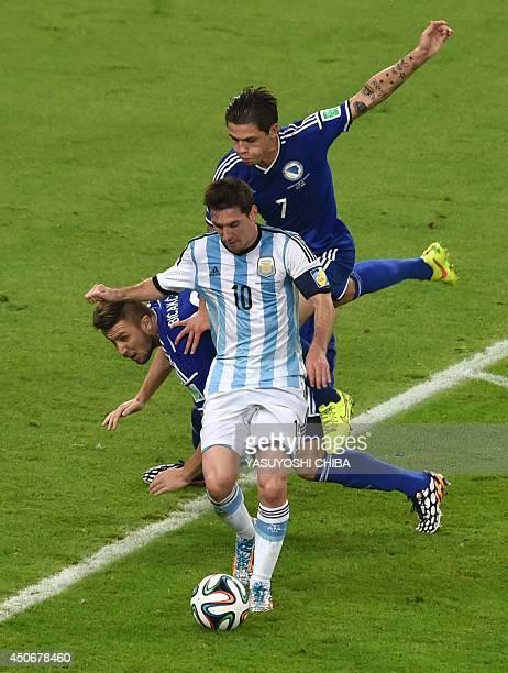 Argentina's forward Lionel Messi vies with BosniaHercegovina's defender Ermin Bicakcic and BosniaHercegovina's defender Muhamed Besic during the...