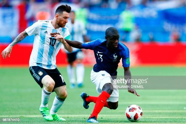 Argentina's forward Lionel Messi vies with France's midfielder N'Golo Kante during the Russia 2018 World Cup round of 16 football match between...