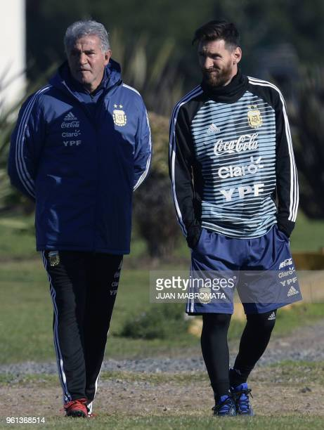 Argentina's forward Lionel Messi walks next to team mannager Jorge Burruchaga during a training session in Ezeiza Buenos Aires on May 22 2018 The...