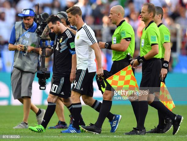 Argentina's forward Lionel Messi walks off the pitch with Argentina's defender Cristian Ansaldi at the end of the Russia 2018 World Cup Group D...