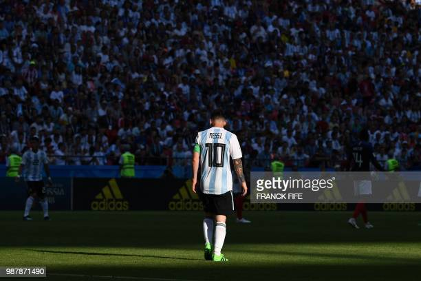 TOPSHOT Argentina's forward Lionel Messi walks on the pitch during the Russia 2018 World Cup round of 16 football match between France and Argentina...