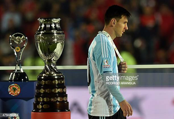 Argentina's forward Lionel Messi walks with the second place medal of the 2015 Copa America football championship in Santiago Chile on July 4 2015...