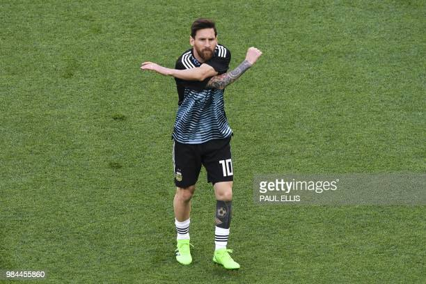 TOPSHOT Argentina's forward Lionel Messi warms up ahead of the Russia 2018 World Cup Group D football match between Nigeria and Argentina at the...