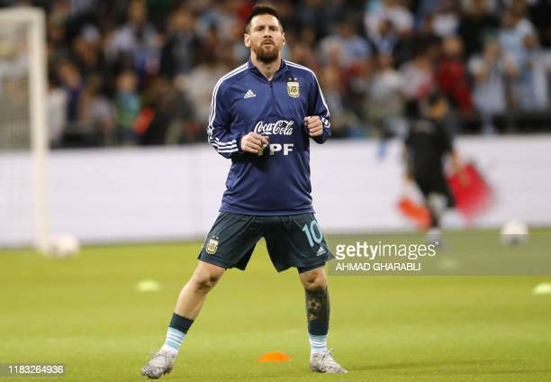 Argentina's forward Lionel Messi warms up before the friendly football match between Argentina and Uruguay at the Bloomfield stadium in the Israeli...