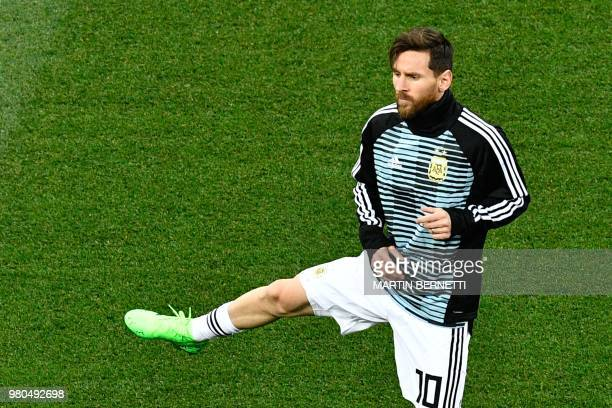 Argentina's forward Lionel Messi warms up before the Russia 2018 World Cup Group D football match between Argentina and Croatia at the Nizhny...
