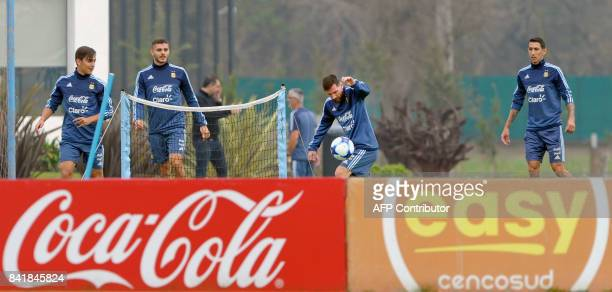 Argentina's forward Lionel Messi with his teammates forwards Mauro Icardi Pablo Dybala and midfielder Angel Di Maria takes part in training session...