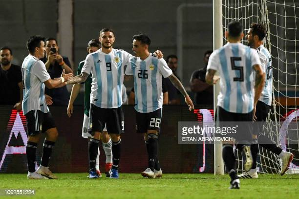Argentina's forward Mauro Icardi celebrates with teammates after scoring his team second goal against Mexico during their friendly football match at...