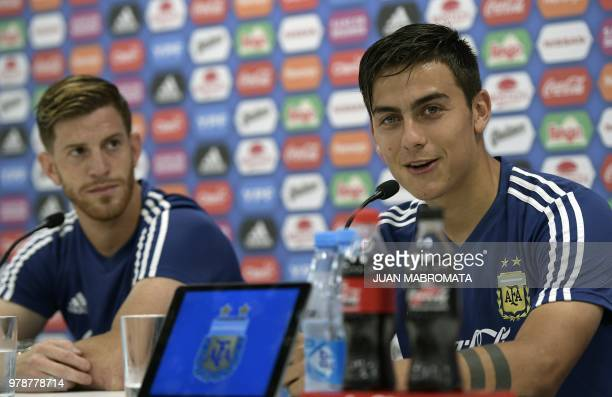 Argentina's forward Paulo Dybala and defender Cristian Ansaldi hold a press conference at the team's base camp in Bronnitsy near Moscow on June 19...