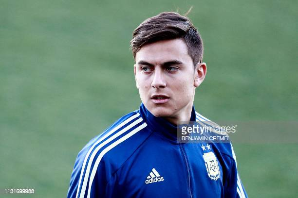 Argentina's forward Paulo Dybala arrives for a training session at Real Madrid's training facilities of Valdebebas in Madrid on March 20 ahead of an...
