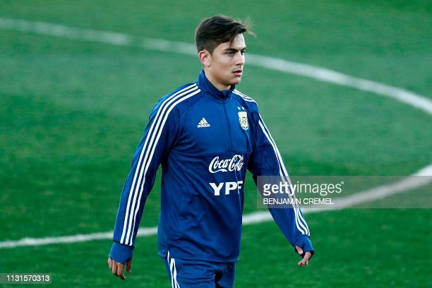 Argentina's forward Paulo Dybala attends a training session at the Real Madrid's training facilities of Valdebebas in Madrid on March 19 ahead of the...