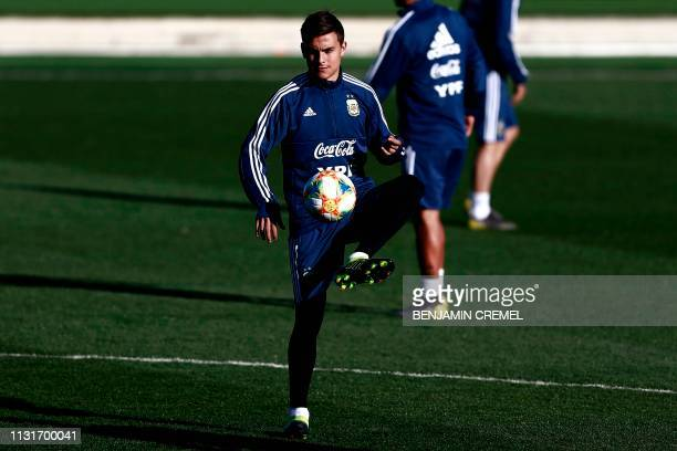 Argentina's forward Paulo Dybala controls a ball during a training session at Real Madrid's training facilities of Valdebebas in Madrid on March 20...