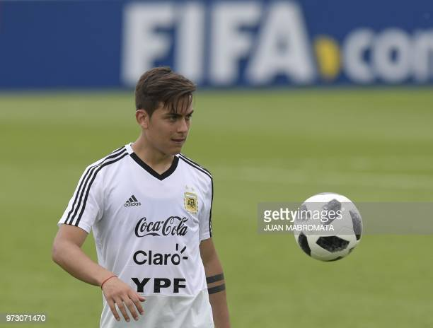 Argentina's forward Paulo Dybala takes part in a training session at the team's base camp in Bronnitsy on June 13 2018 ahead of the Russia 2018 World...