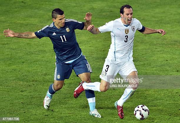 Argentina's forward Sergio Aguero and Uruguay's defender Diego Godin vie during their 2015 Copa America football championship match, in La Serena,...