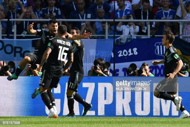 Argentina's forward Sergio Aguero celebrates with teammates after scoring a goal during the Russia 2018 World Cup Group D football match between...