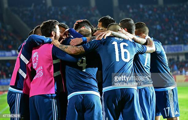 Argentina's forward Sergio Aguero celebrates with teammates after scoring against Uruguay during their 2015 Copa America football championship match...