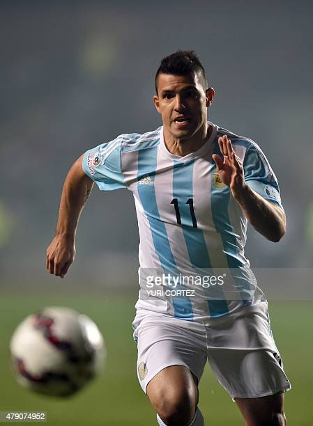Argentina's forward Sergio Aguero controls the ball during their Copa America semifinal football match against Paraguay in Concepcion, Chile on June...