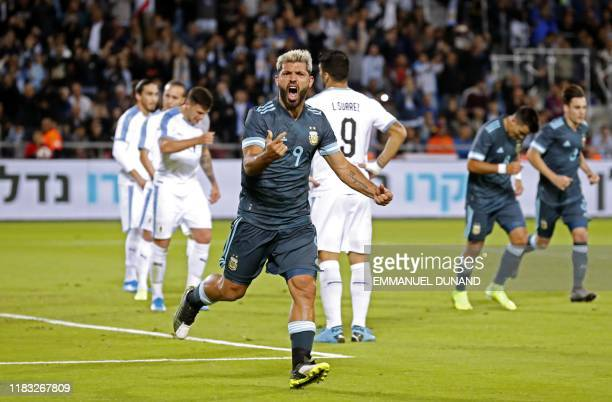 Argentina's forward Sergio Aguero gestures after scoring during the friendly football match between Argentina and Uruguay at the Bloomfield stadium...