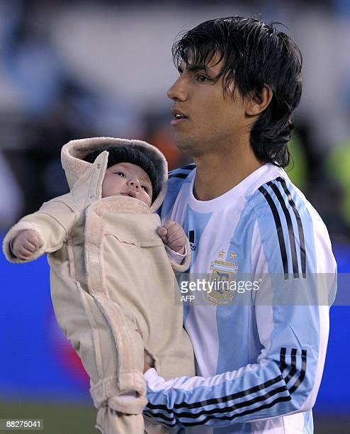 Argentina's forward Sergio Aguero holds his son Benjamin Aguero Maradona before the FIFA World Cup South Africa2010 qualifier football match against...