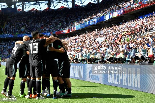 TOPSHOT Argentina's forward Sergio Aguero is congratulated by teammates after scoring the opening goal during the Russia 2018 World Cup Group D...