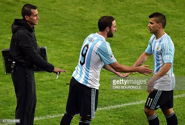 Argentina's forward Sergio Aguero is replaced by Gonzalo Higuain during the 2015 Copa America football championship match in La Serena Chile on June...