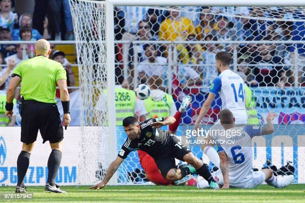 Argentina's forward Sergio Aguero scores a goal during the Russia 2018 World Cup Group D football match between Argentina and Iceland at the Spartak...