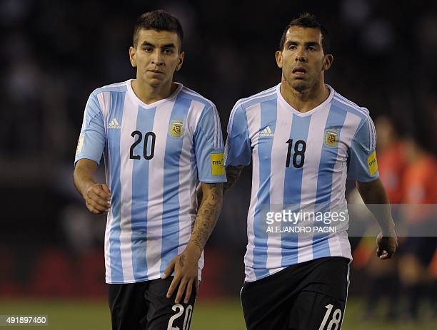 Argentina's forwards Angel Correa and Carlos Tevez are seen during their Russia 2018 FIFA World Cup qualifiers match against Ecuador at the...