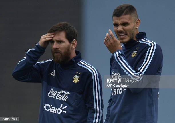 Argentina's forwards Lionel Messi and Mauro Icardi gesture during a training session in Ezeiza Buenos Aires on August 29 2017 ahead of their FIFA...