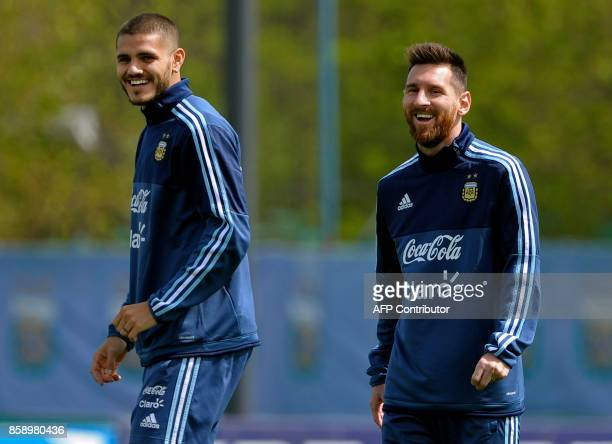 Argentina's forwards Lionel Messi and Mauro Icardi laugh during a training session in Ezeiza Buenos Aires on October 8 2017 ahead of a 2018 FIFA...