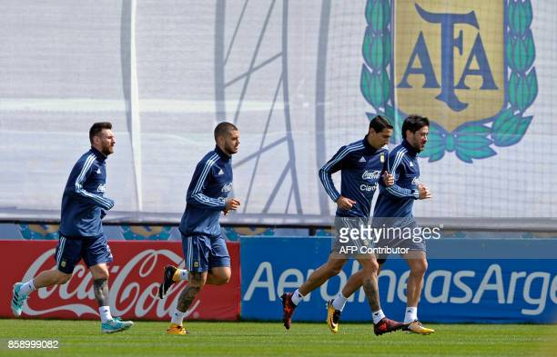 Argentina's forwards Lionel Messi Mauro Icardi and midfielders Angel Di Maria and Pablo Perez run during a training in Ezeiza Buenos Aires on October...
