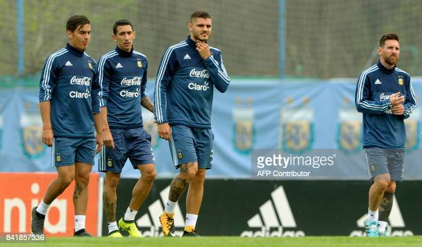 Argentina's forwards Lionel Messi Mauro Icardi Paulo Dybala and midfielder Angel Di Maria prepare to take part in a training session in Ezeiza Buenos...