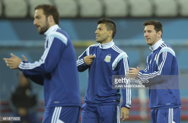 Argentina's forwards Lionel Messi Sergio Aguero and Gonzalo Higuain take part in a training session at the Arena de Sao Paulo Stadium on July 08 on...