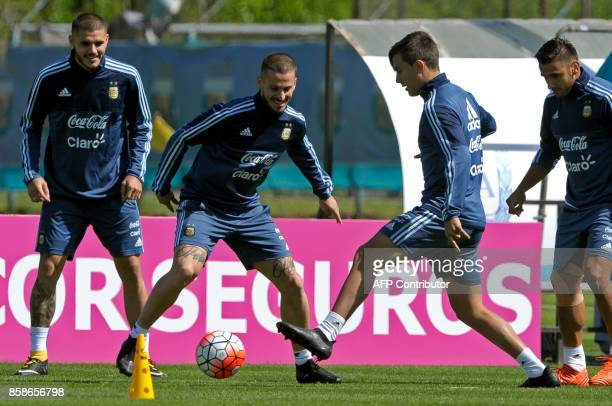 Argentina's forwards Paulo Dybala Dario Benedetto and Mauro Icardi take part in a training session in Ezeiza Buenos Aires on October 7 2017 ahead of...
