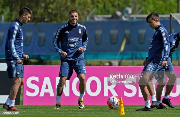 Argentina's forwards Paulo Dybala Mauro Icardi and midfielder Emiliano Rigoni take part in a training session in Ezeiza Buenos Aires on October 7...